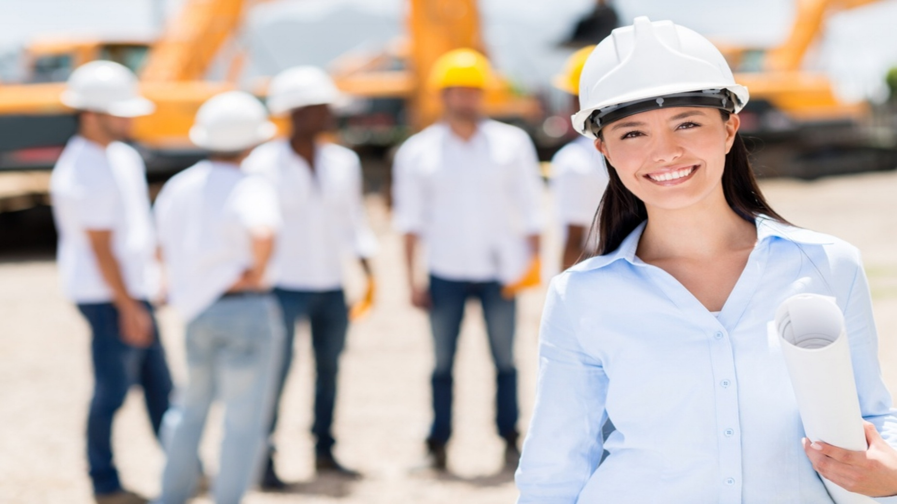 Female architect at a construction site looking happy-204220-edited.jpeg