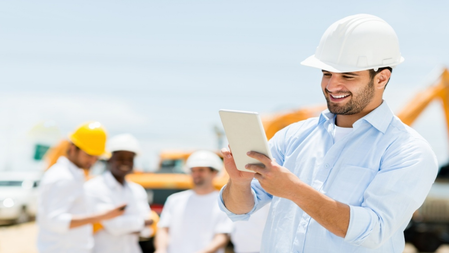 Male engineer at a construction site with a tablet computer-866327-edited.jpeg