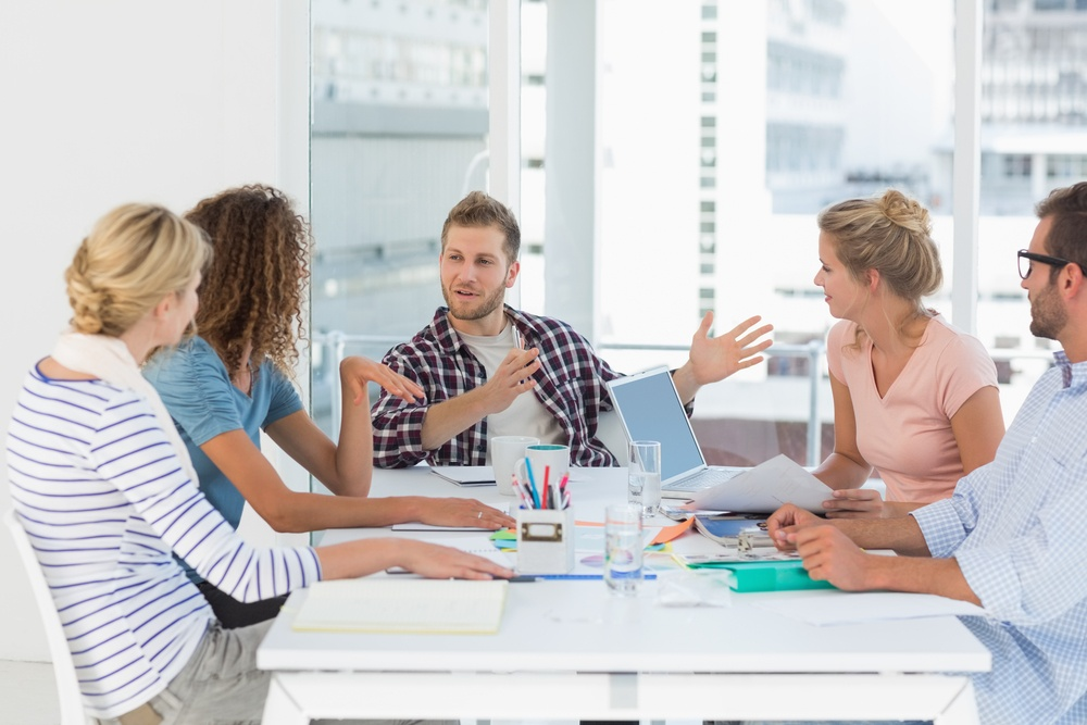 Young design team having a meeting together in creative office.jpeg